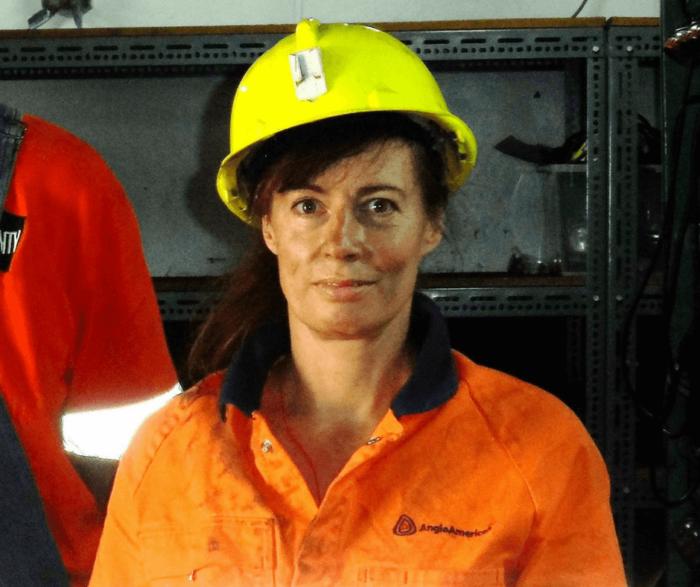 Julie Garland McLellan wearing a yellow hard hat