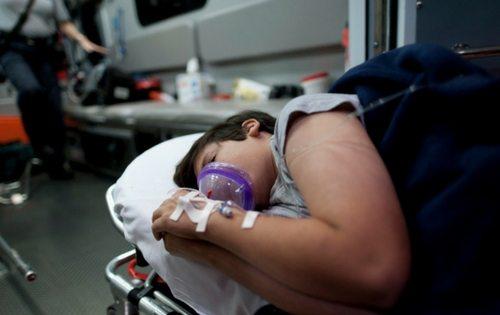 Kid in ambulance with ventilator