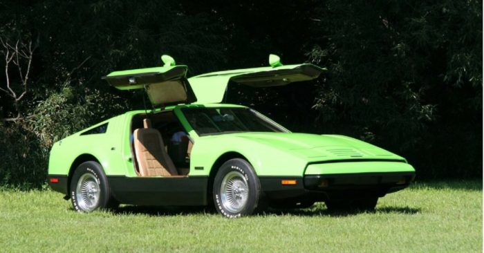 Lurid paint on green gull-winged car