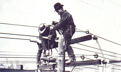 Electricians working on high voltage electrical lines