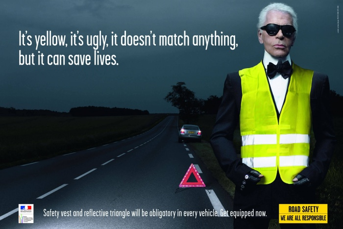 Karl Lagerfeld wearing safety vest