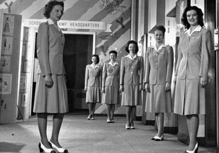 Female elevator operators lined up