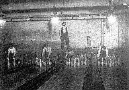 Pinsetters placing bowling pins on bowling alleys