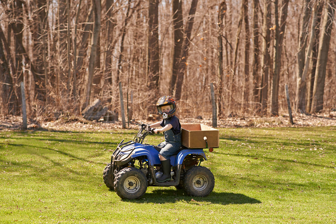 Child on an ATV quad bike