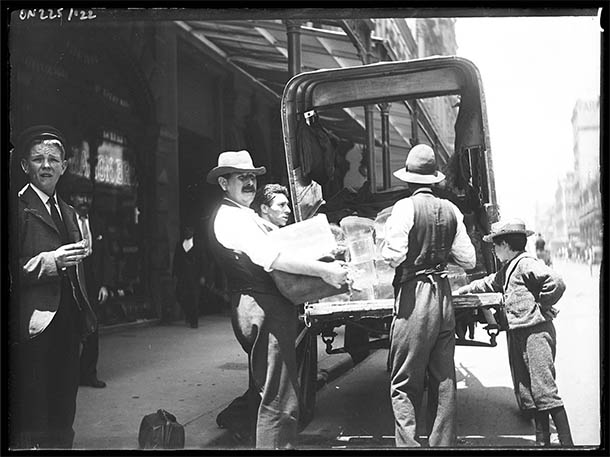 Ice delivery man loading truck