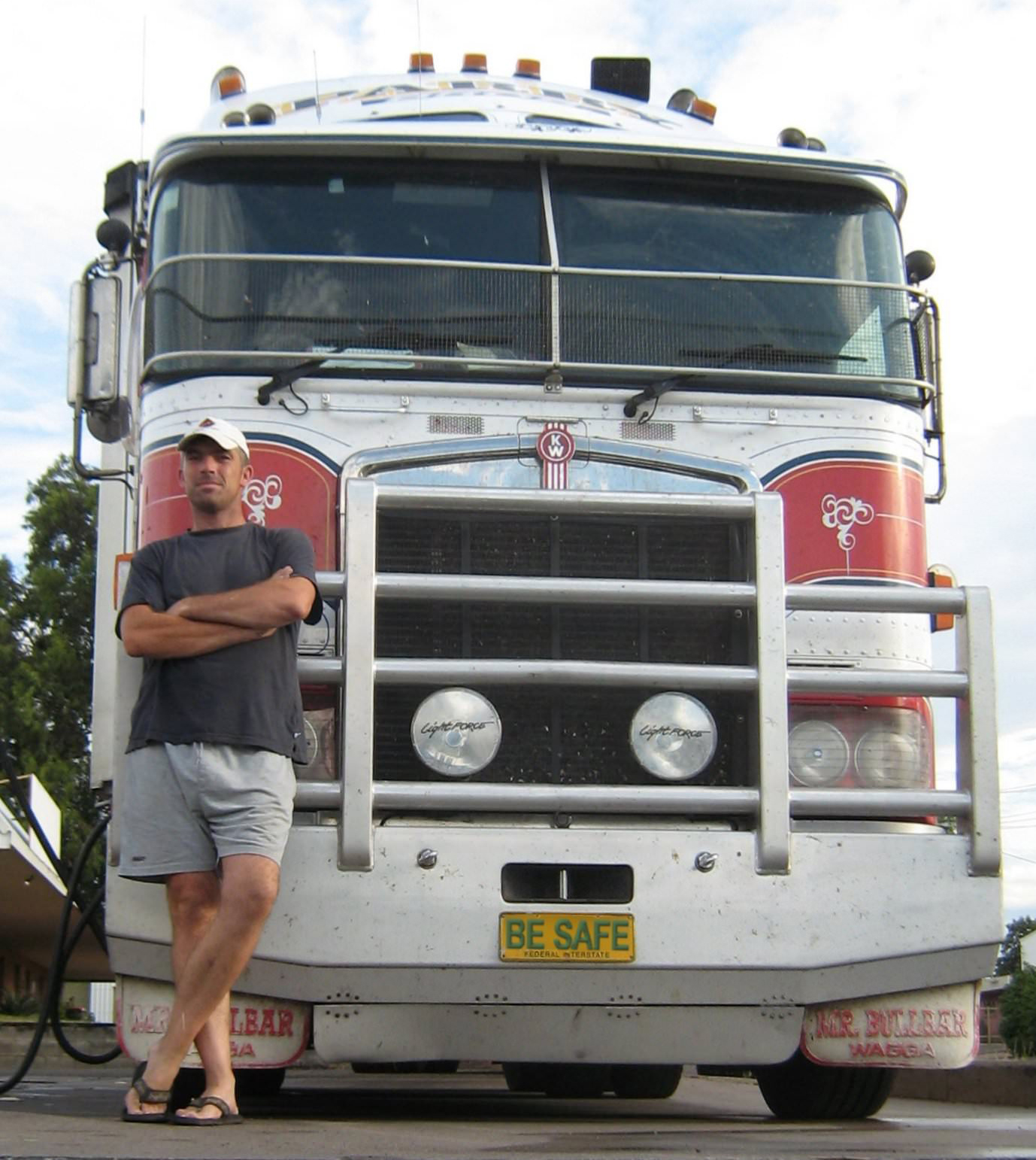 Aussie Truckie Matt in front of his red and white truck