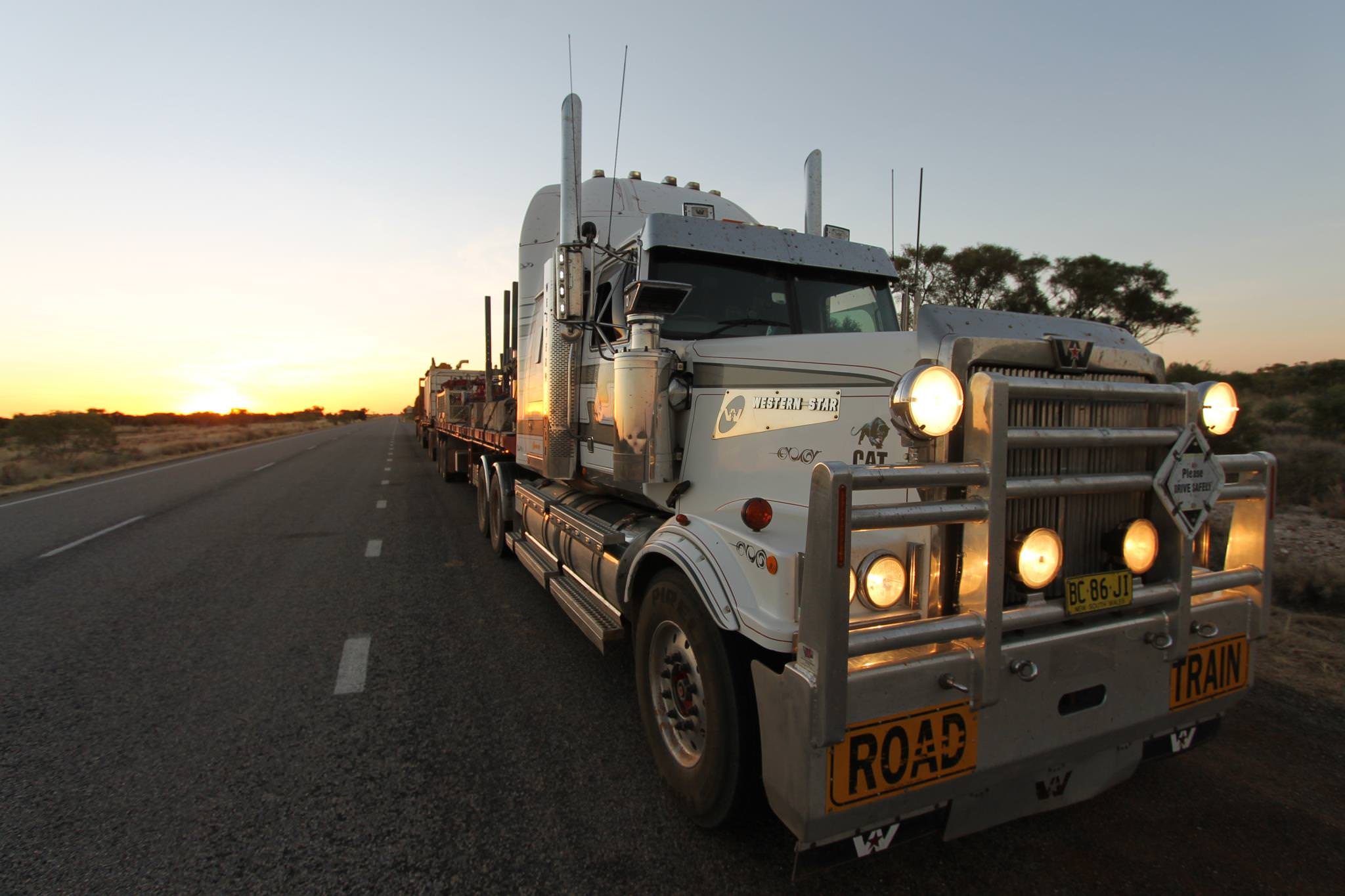 Western Star road train truck on Aussie road at sunset