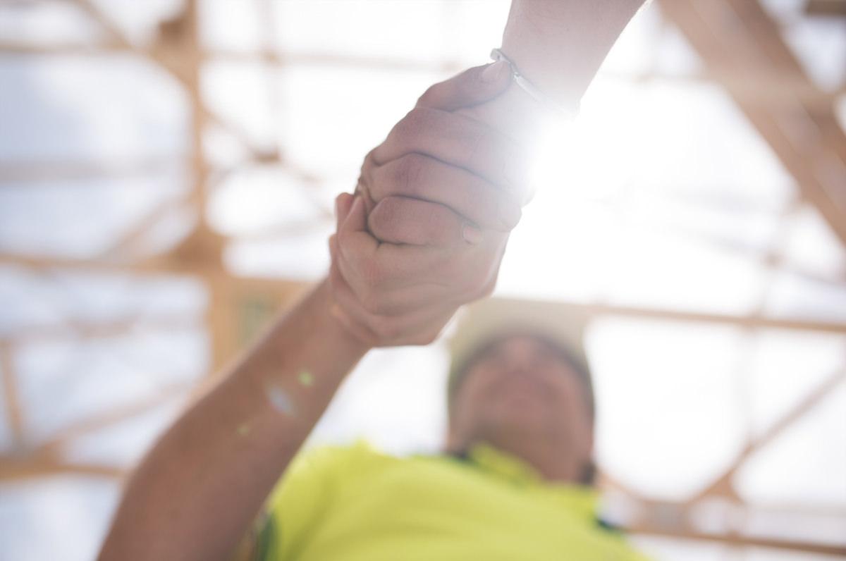 Tradie workers shaking hands