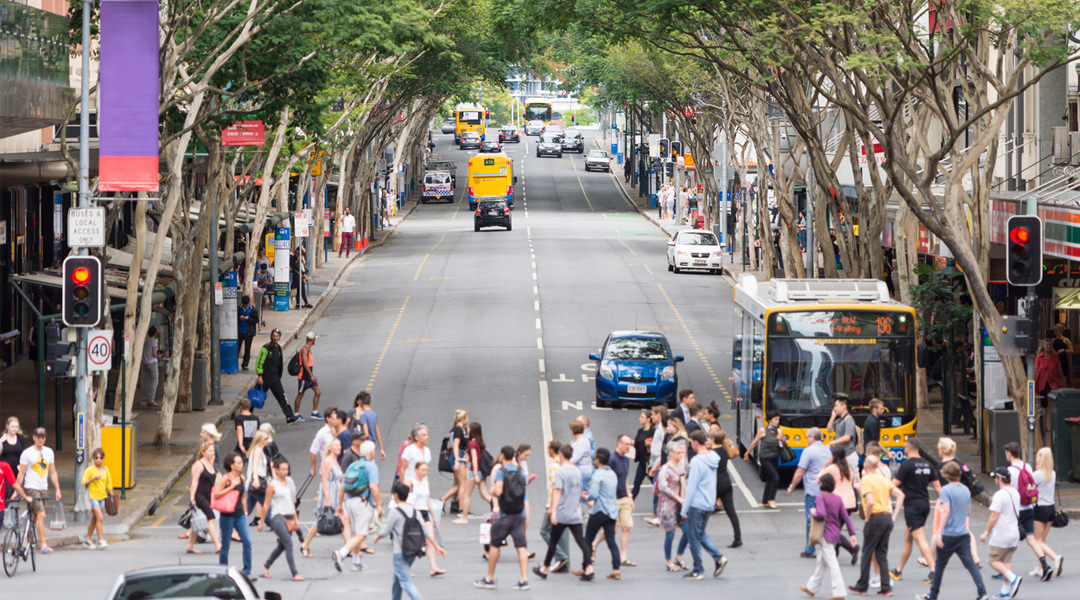 Pedestrians at busy crossing in Brisbane