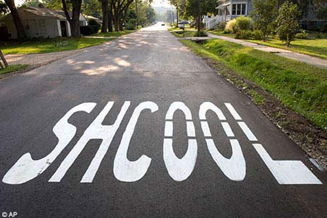 Residential street, misspelled word written on asphalt