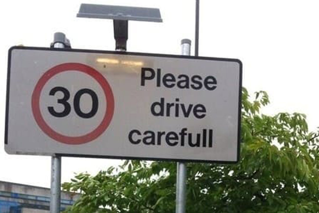 Road sign with typo