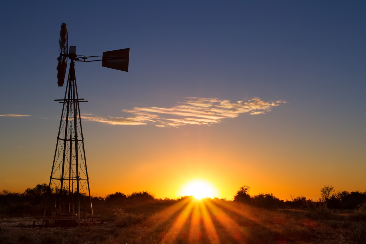 Farm, wind turbine, sun rising in Australia