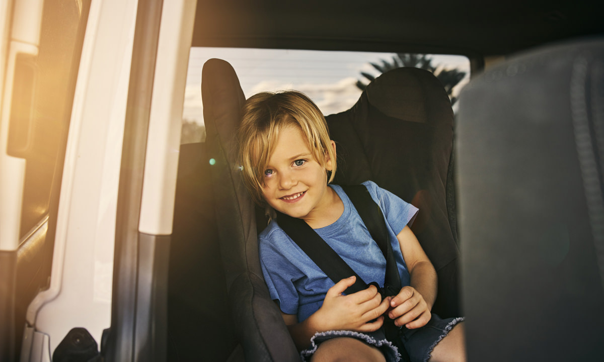Kid in child seat of car