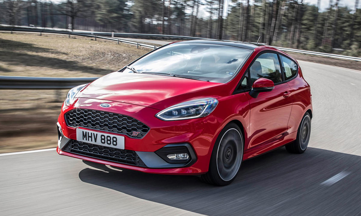 Red Ford Fiesta on the road