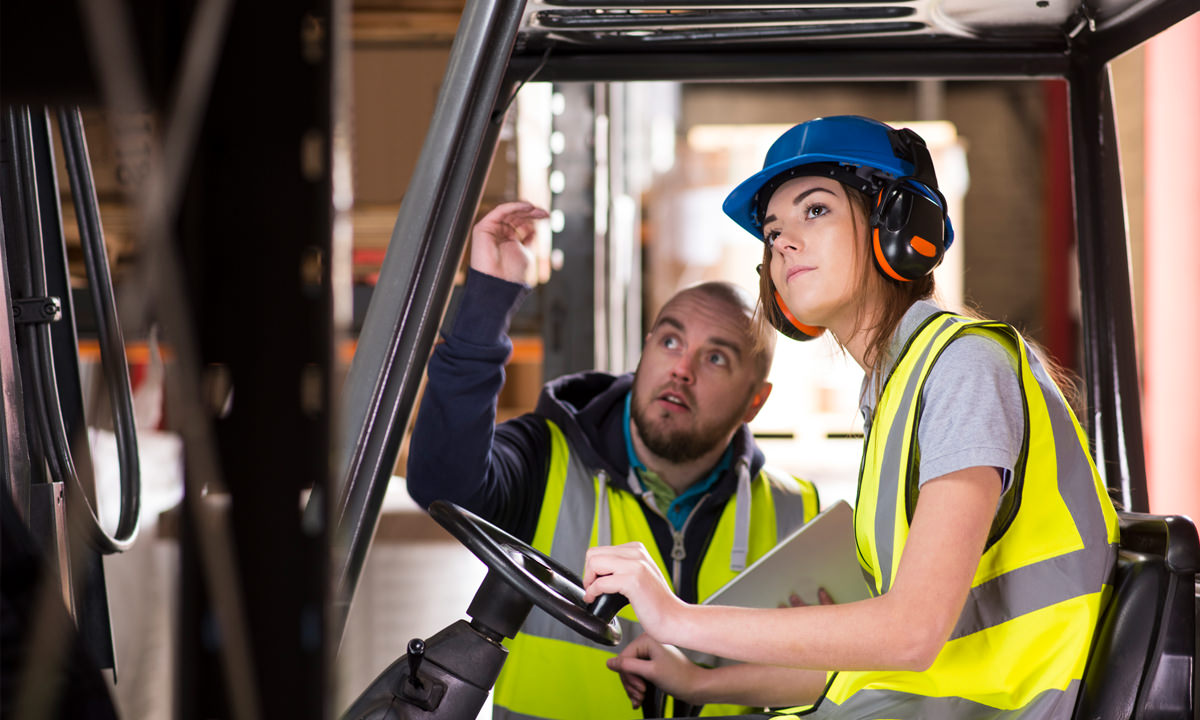 Yound tradie in forklift