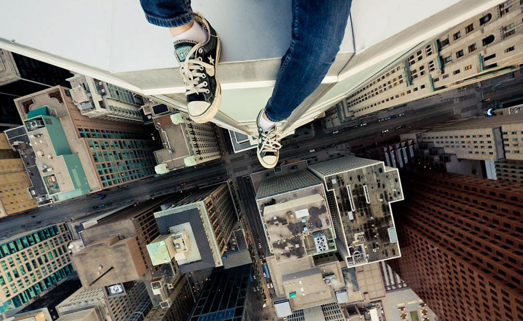 Roof topper with legs over building