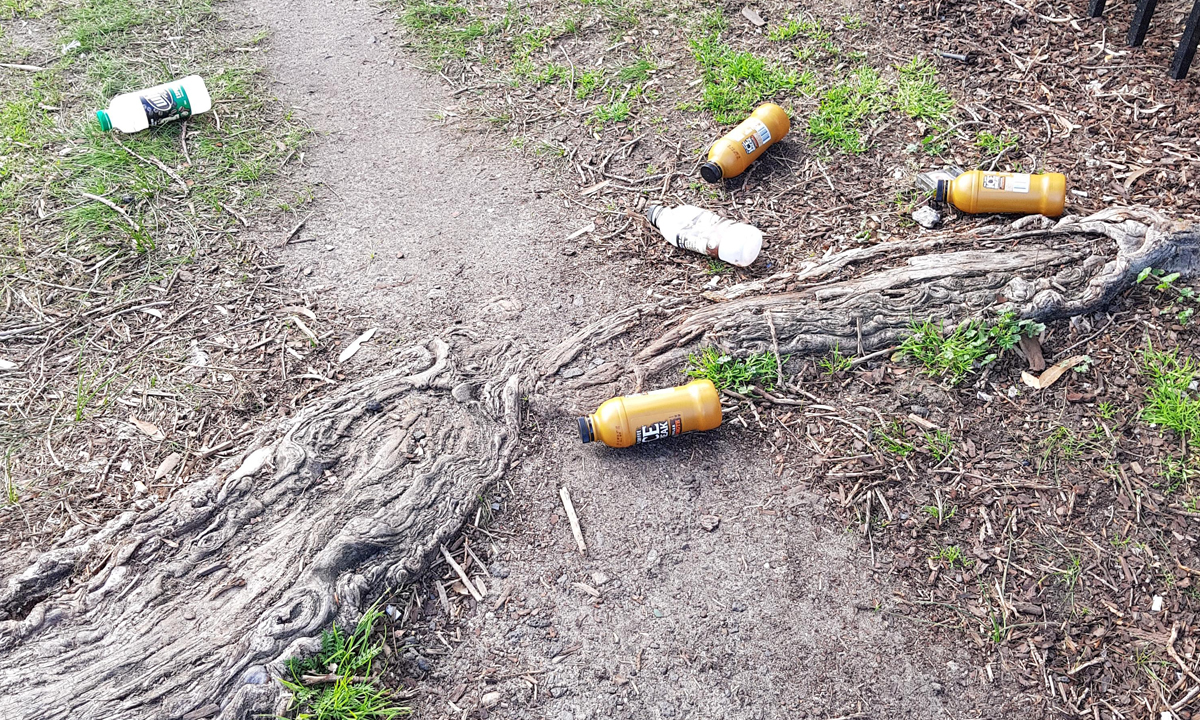Iced coffee bottles on the ground