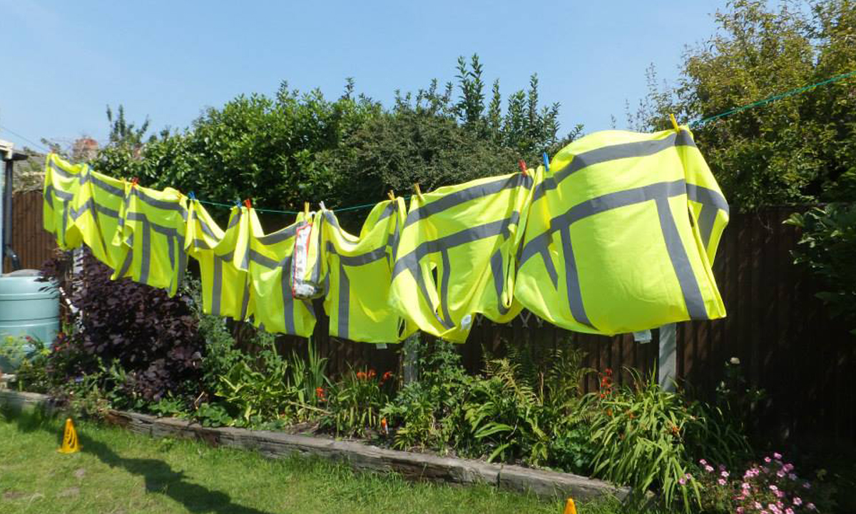 Hi-vis vests hanging from the clohesline