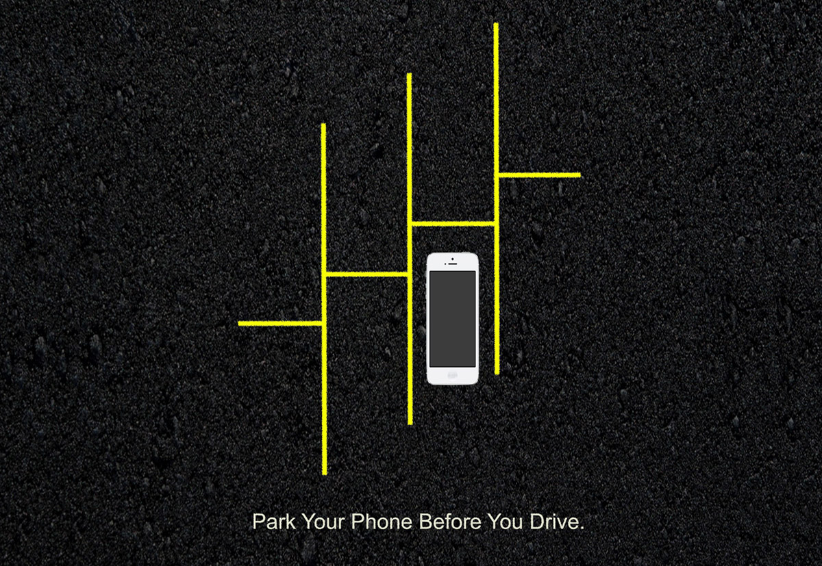 Roas safety ad, asphalt, phone, and parking lines