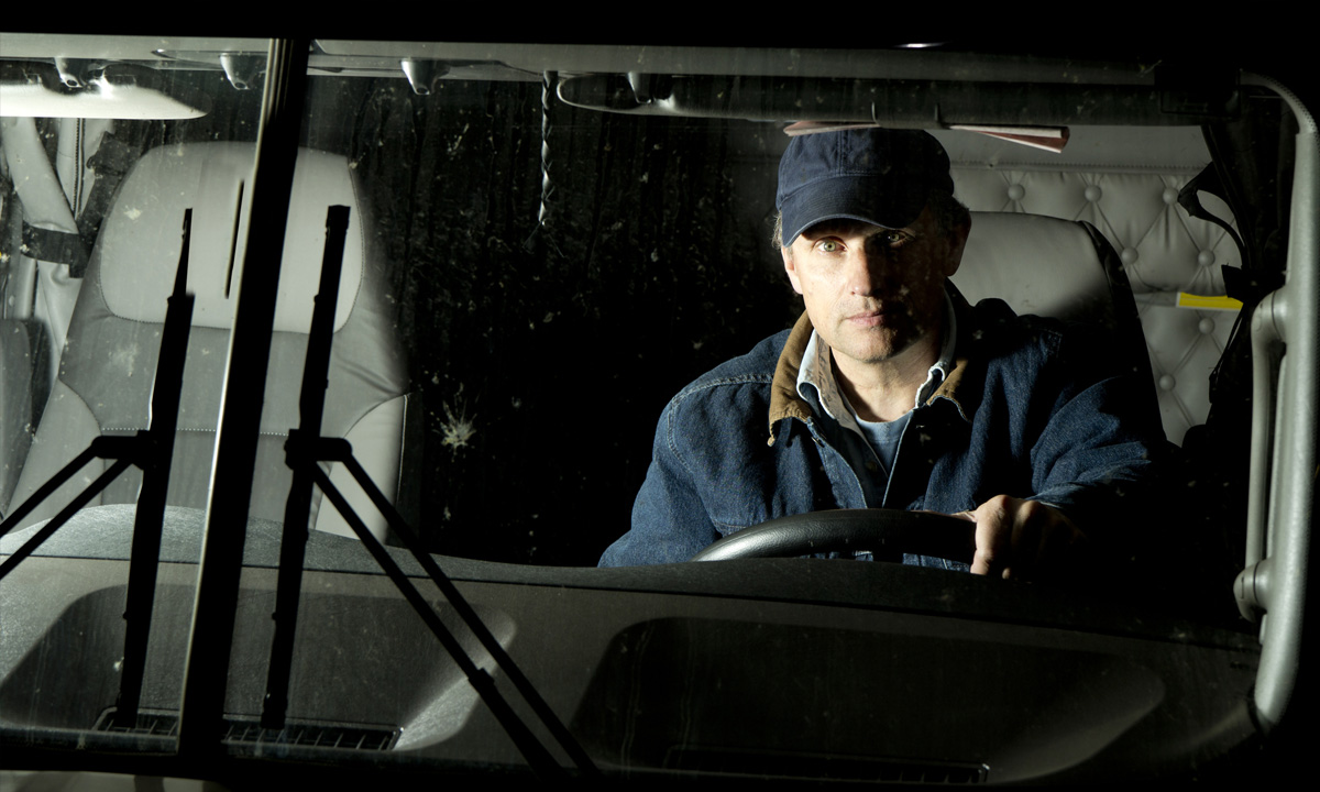 Man driving truck during nightime
