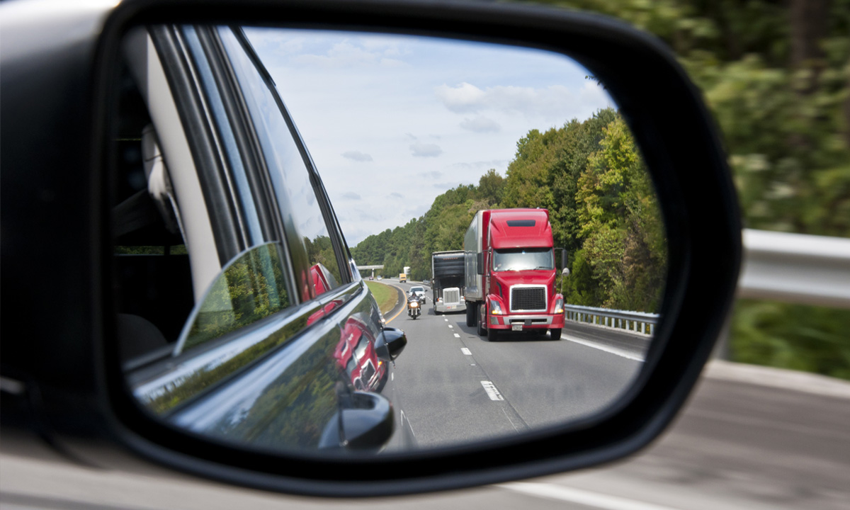 Reflection of trucks in rear view mirror