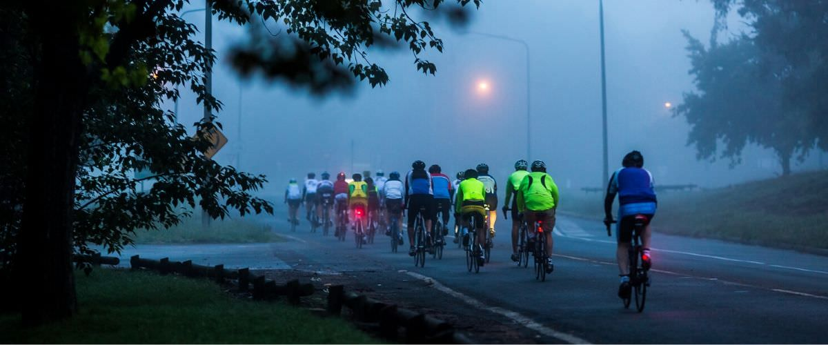 Cyclists on the road on a rainy day