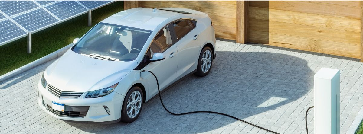 Electric car connected to power source