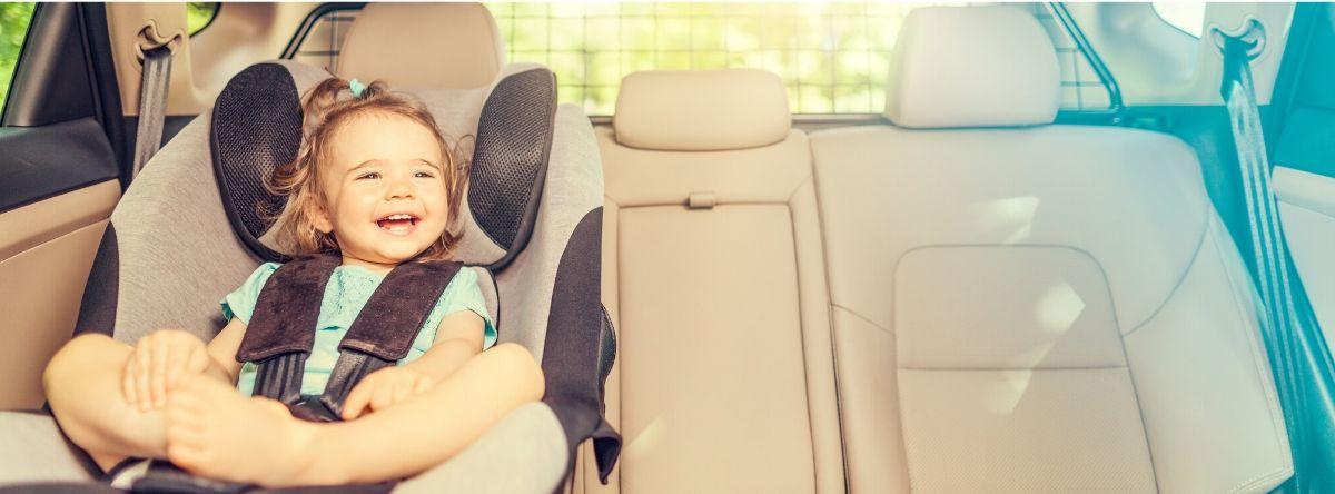 Toddler laughing in car seat