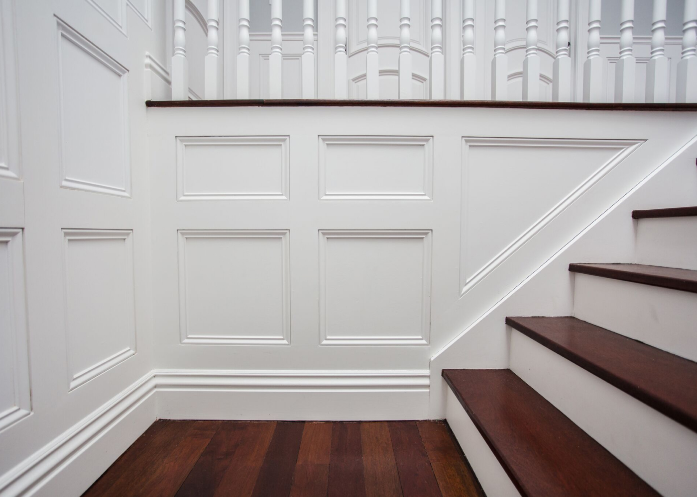 Staircase with baseboards, and panel mould