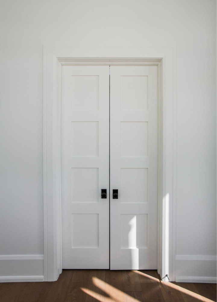 White stile and rail door with casing