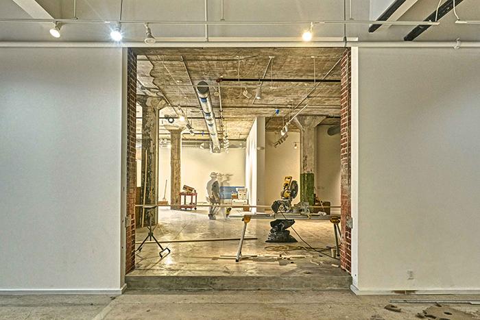 Renovations happening in an open industrial basement space.