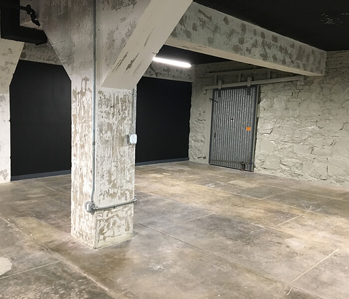 Industrial space with concrete floors and pillar.