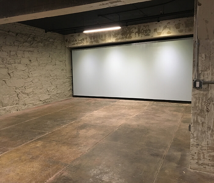 Industrial space with projector screen.