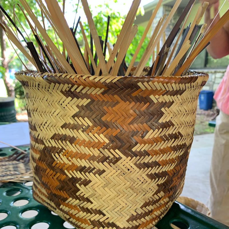 A woven basket with crosshatch pattern.