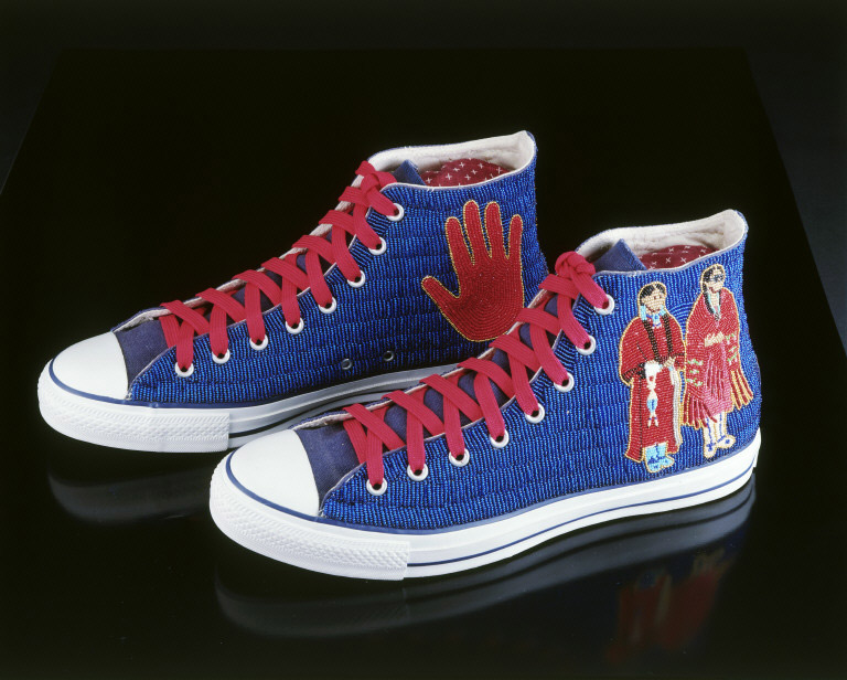 A pair of red and blue sneakers on a black background