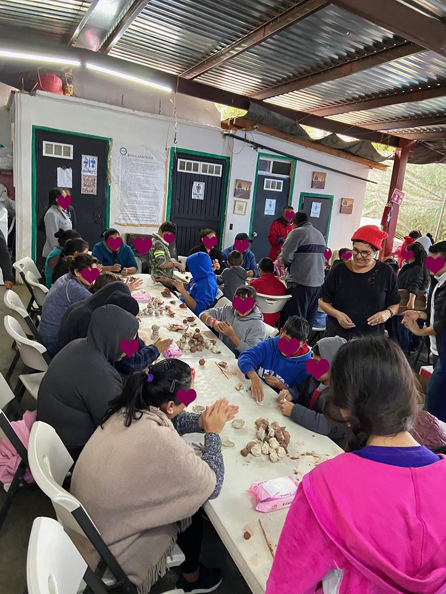 Students of Ceramica Mariposas in Tijuana at ProAmor Asylum learning ceramics.