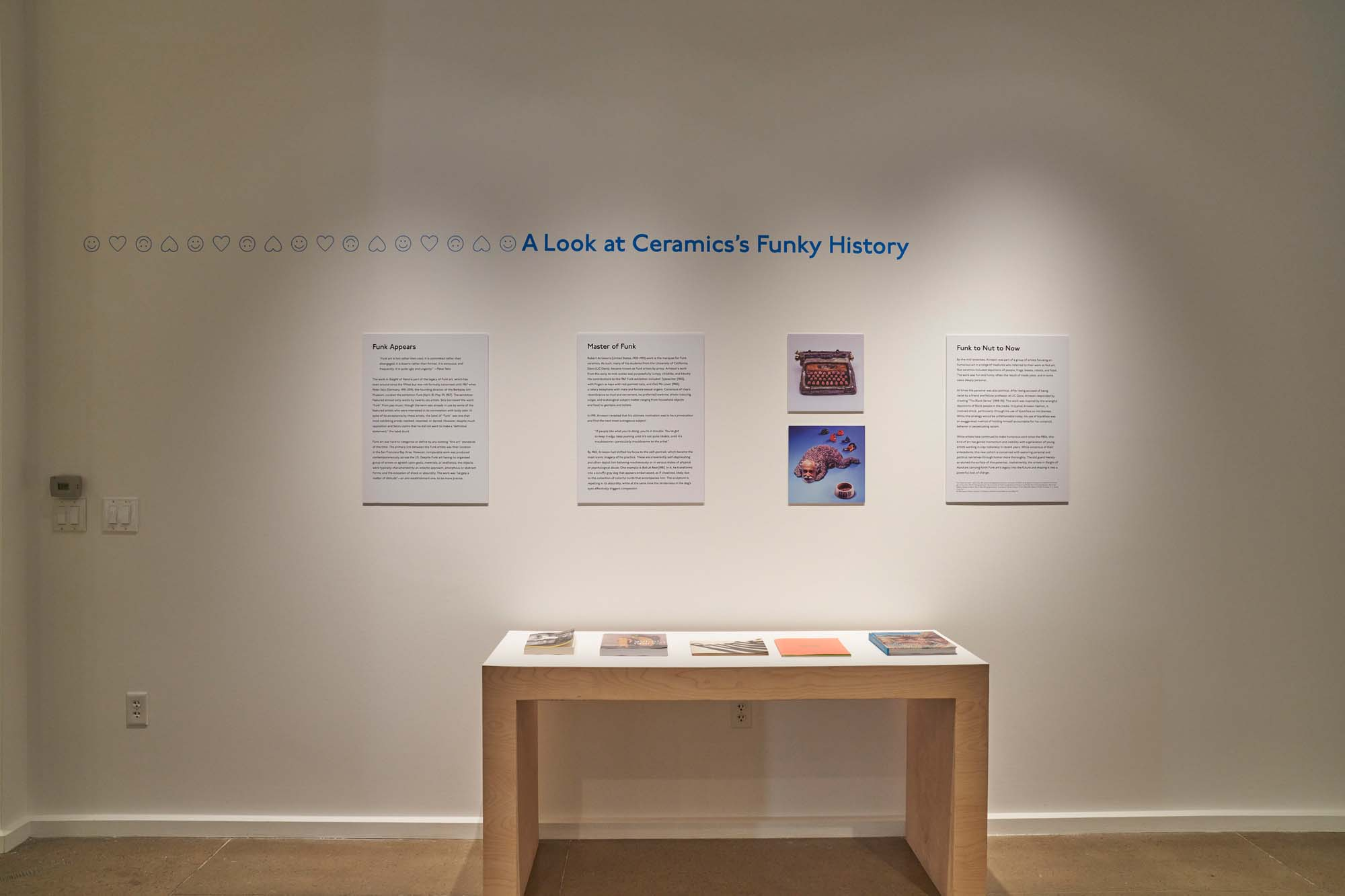 """Image shows a table with publications and text panels about Funk art in American Ceramics. This resource area is titled, """"A Look At Ceramics's Funky History""""."""