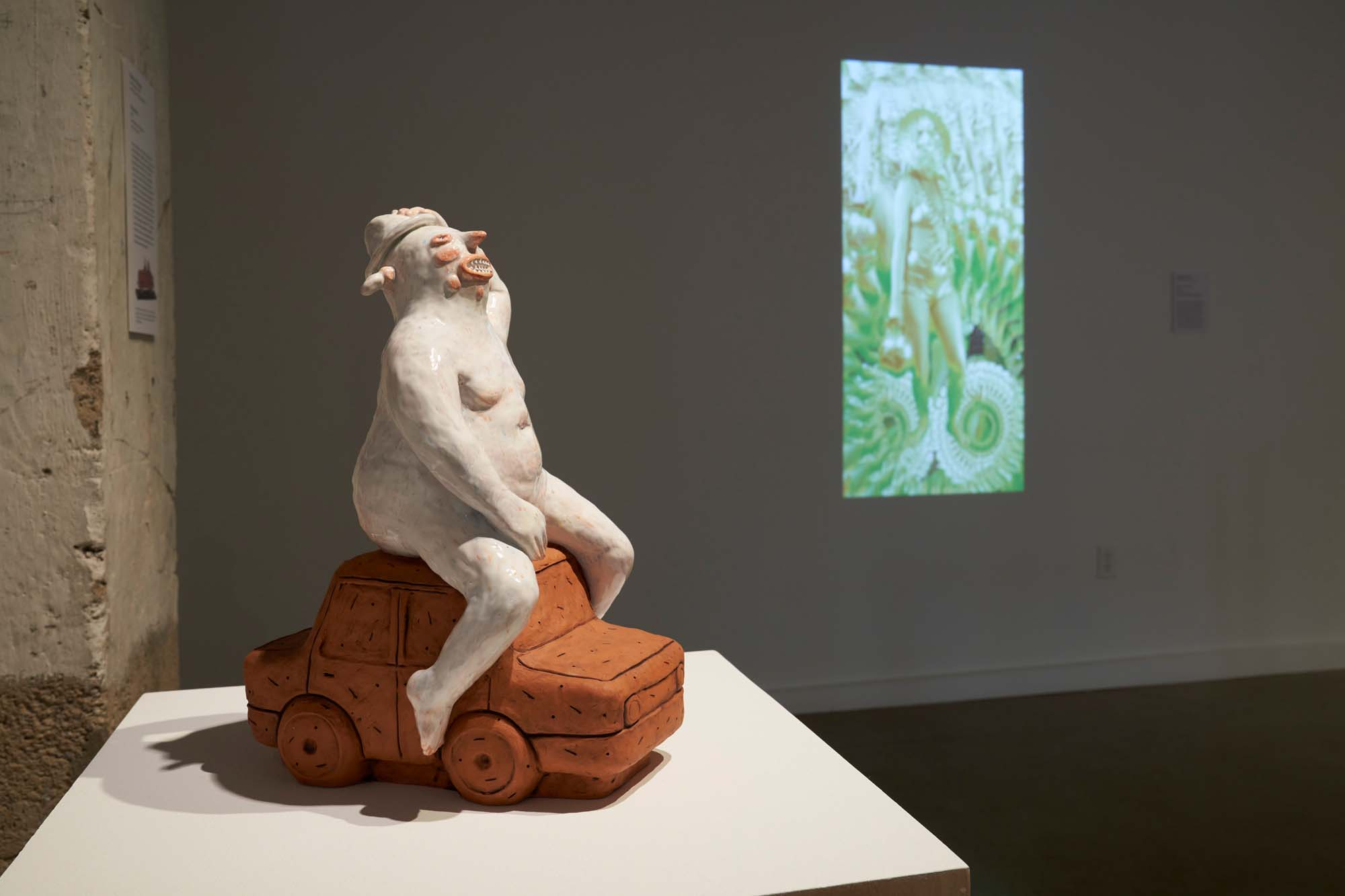 "Image of one ceramic sculpture, ""Warashina"" and one video projection, ""El Dorado Ritual"" by artist Natalia Arbelaez."