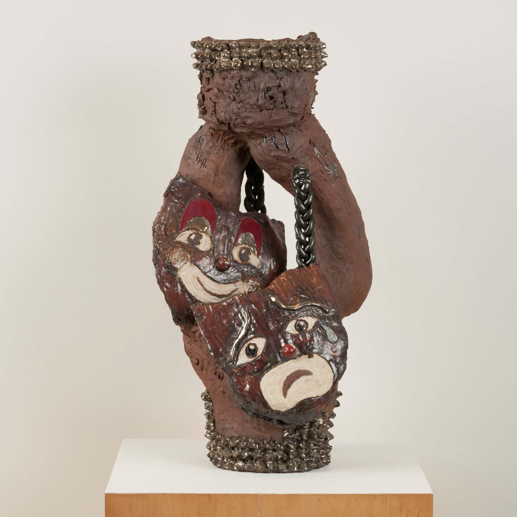 "Image of ceramic sculpture ""Smile Now Cry Later"" by Diana Yesenia Alvarado."