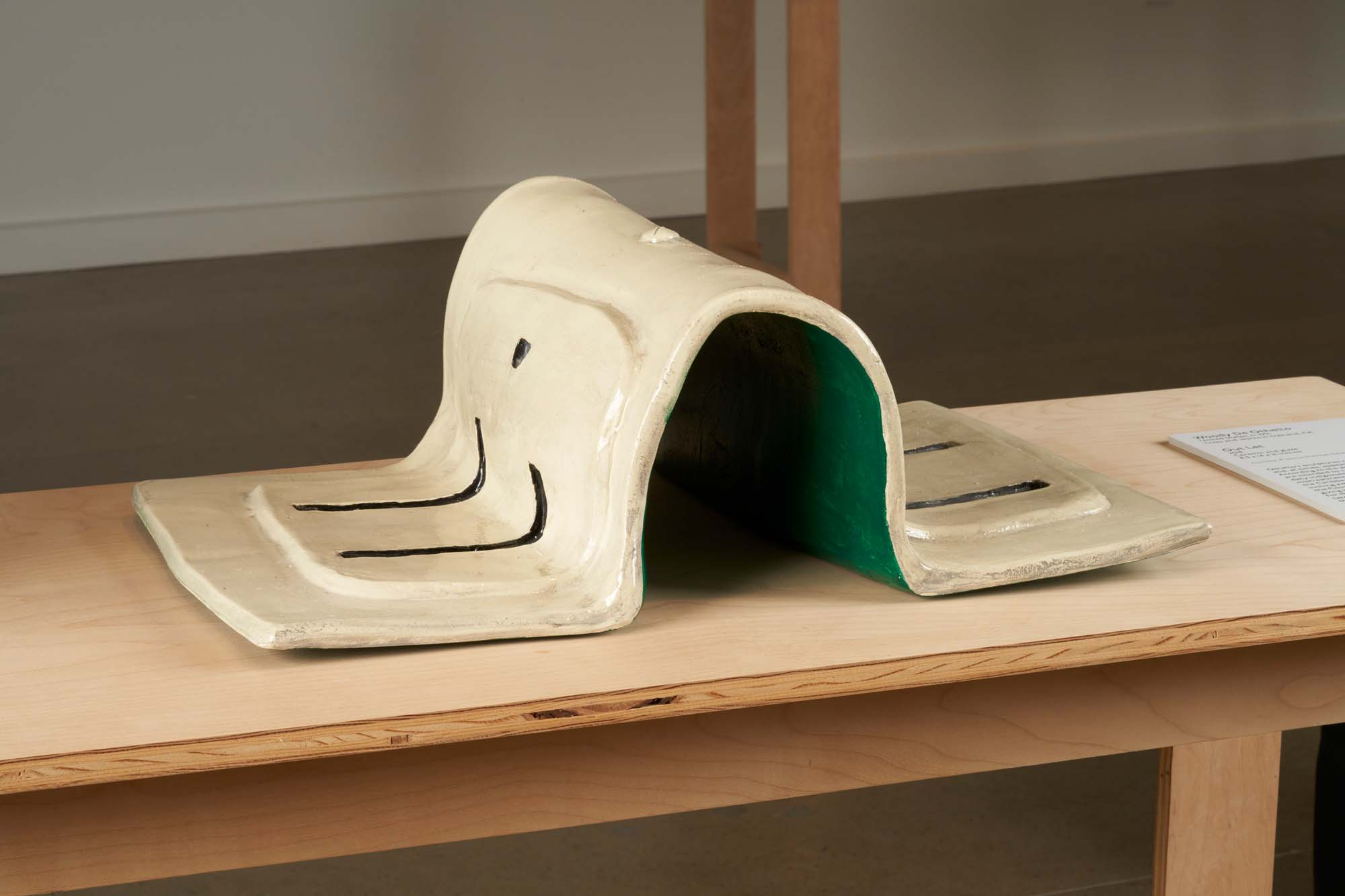 """Image of """"Out Let"""" by Woody De Othello, a ceramic sculpture of an electrical outlet."""
