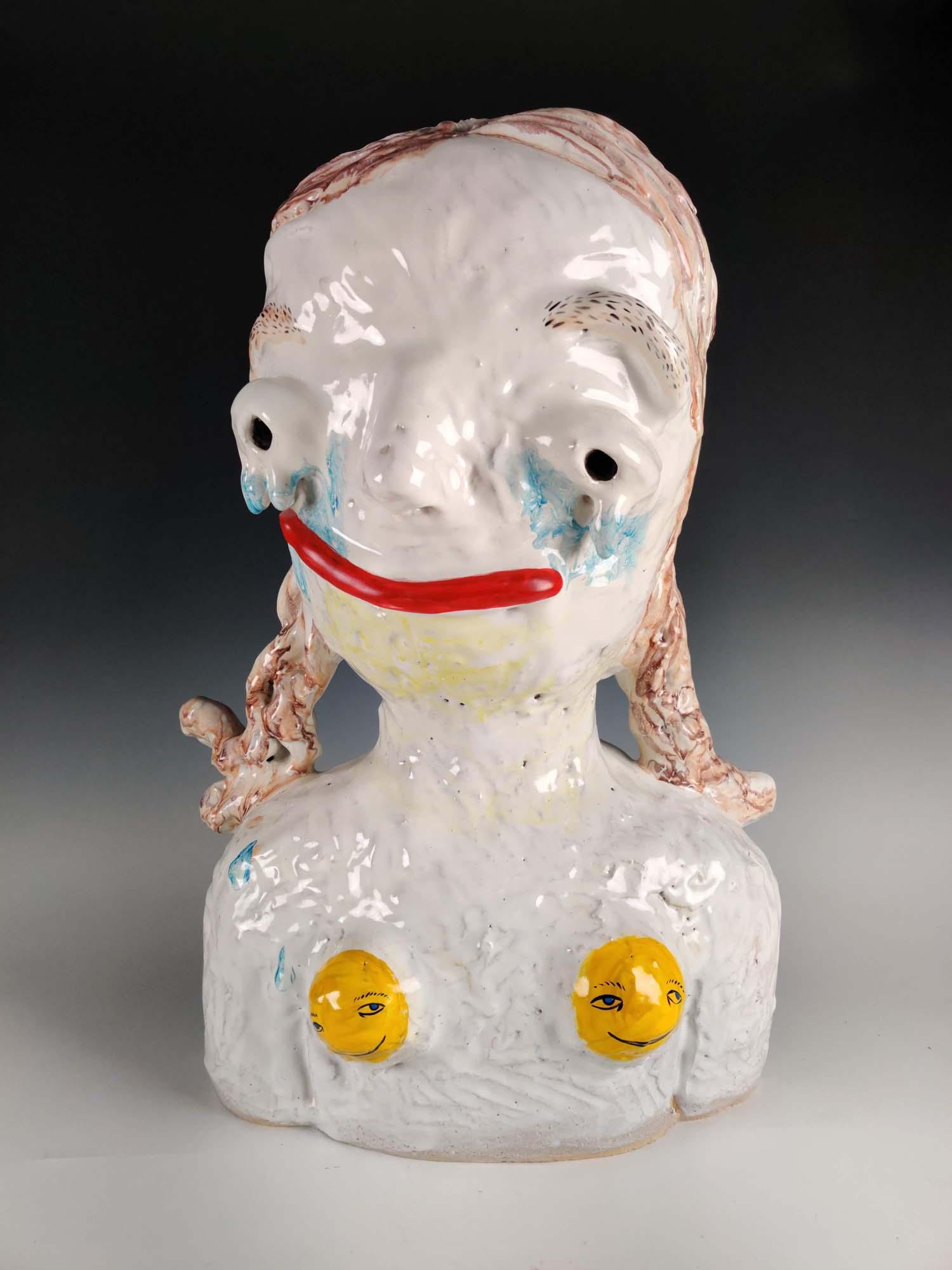 cartoon-like ceramic bust of a smiling girl