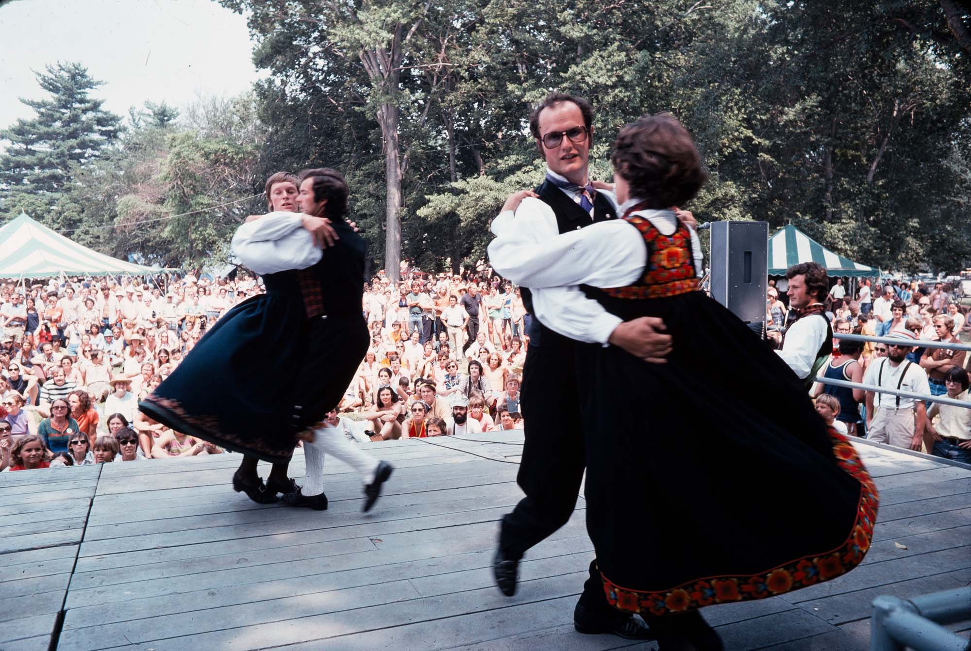 photo of scandinavian dancers in traditional clothing, on stage at a festival in 1974