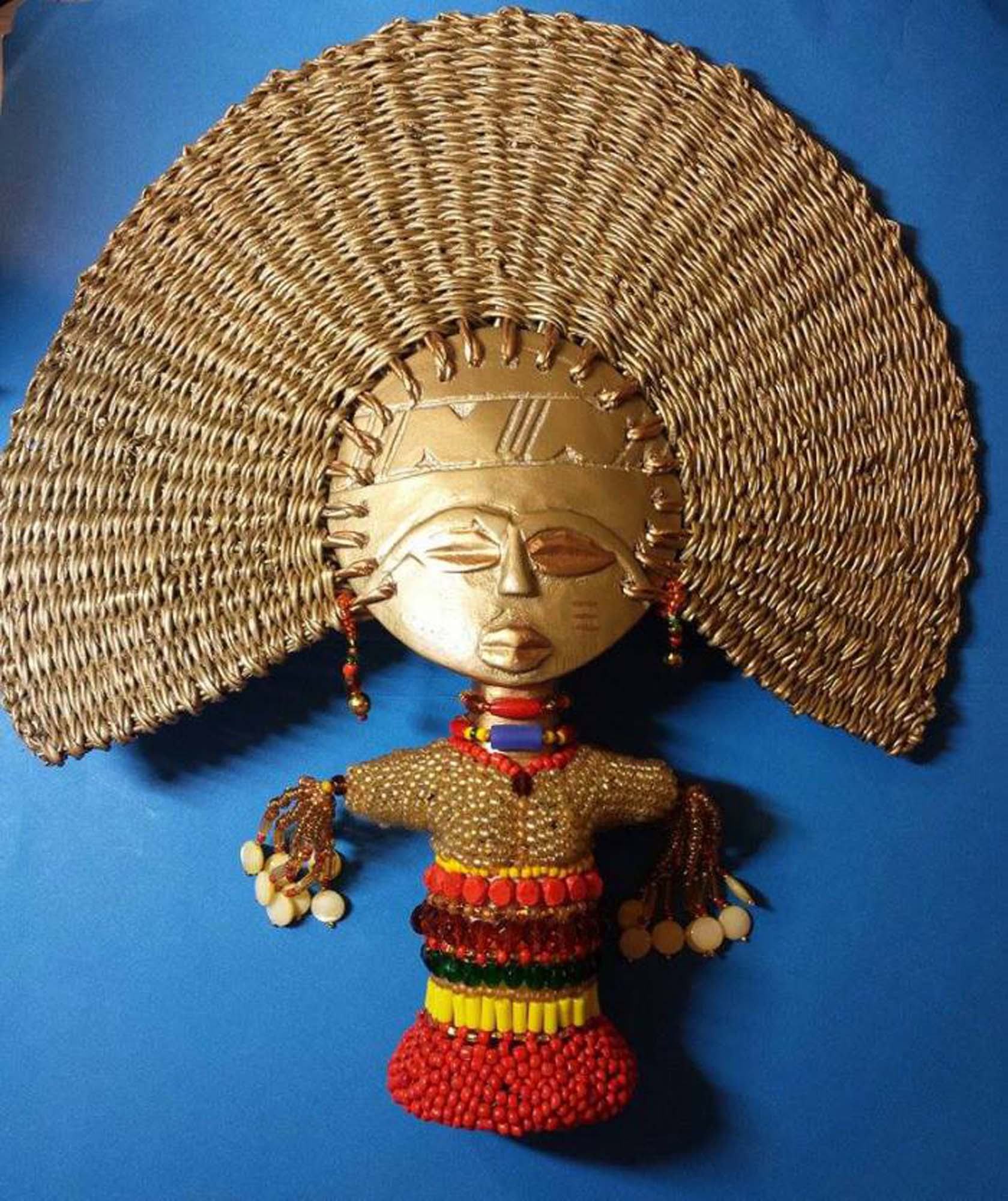 beaded and gold fan of river goddess oshun