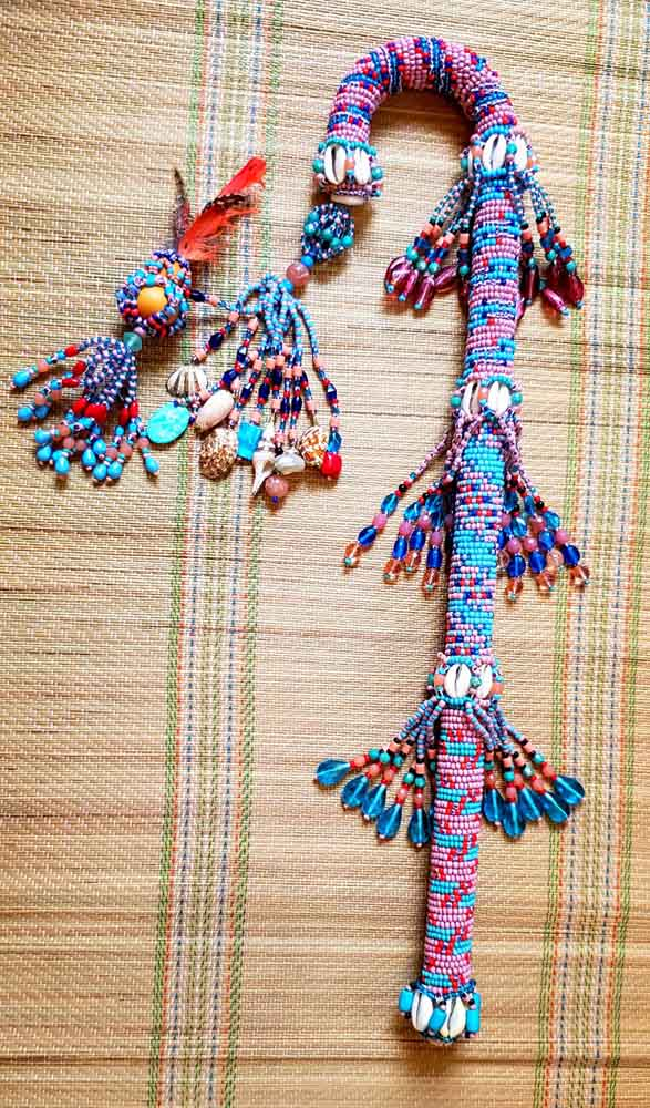 beaded cane staff on bamboo mat