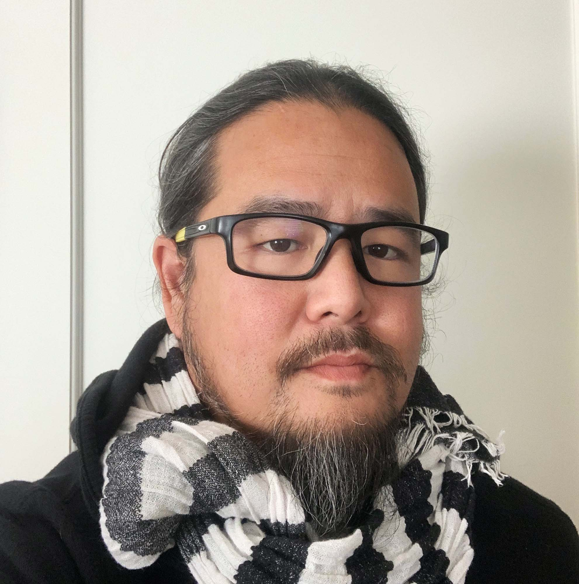 selfie of a man wearing a scarf and glasses