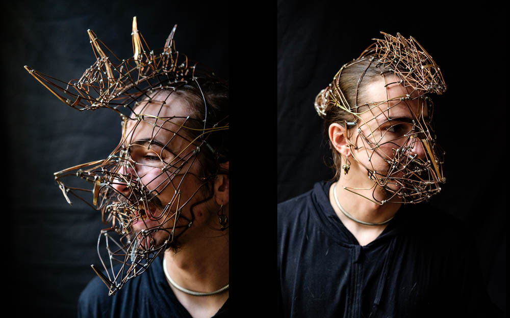 Intricate mask worn by maker Eli Secrest, shown in two photos side-by-side, modeling two forms of a mask that opens and closes.