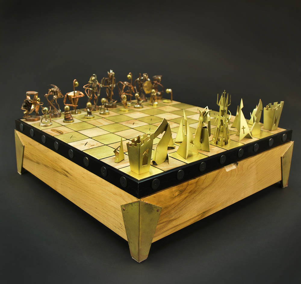 A handmade metal, resin, and felt chess set by Windgate-Lamar Fellow Eli Secrest.