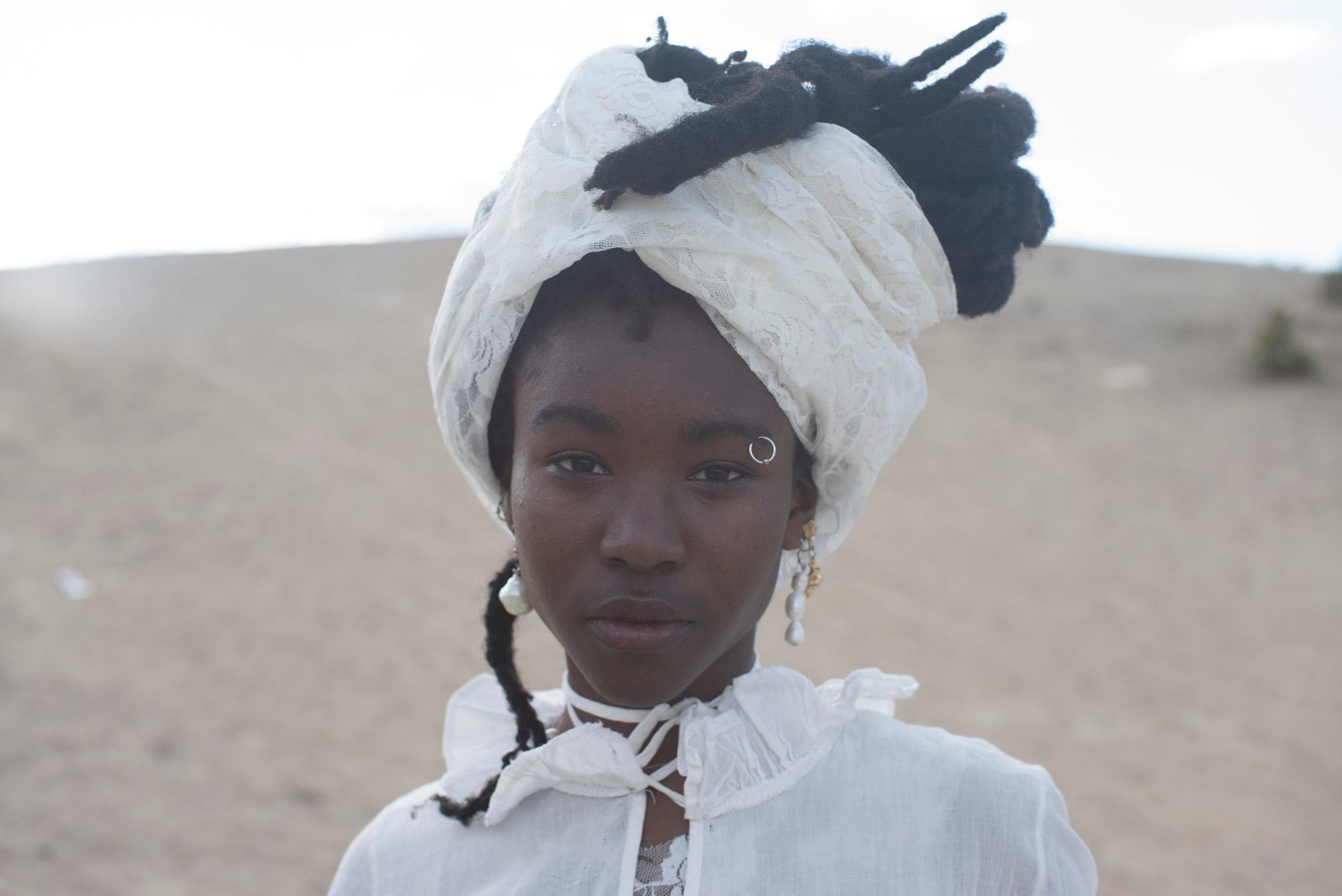 Closeup image of a model wearing a handmade dress by Windgate-Lamar Fellow Hera Ford