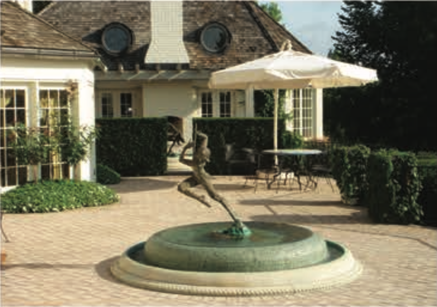 Water fountain feature in front of a home