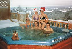 A Family enjoying their ECOsmarte spa in the middle of a snowy Christmas.
